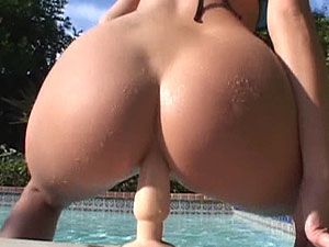 Horny blonde slides down a thick dildo